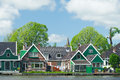 Row houses in typical dutch village green wooden Stock Image