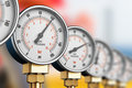 Row of industrial high pressure gas gauge meters Royalty Free Stock Photo