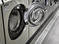 A row of industrial washing machines Royalty Free Stock Images