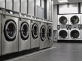 A row of industrial washing machines Stock Image