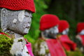 A row of japense jizo statues in ganman ga fuchi abyss near nikko honshu japan Royalty Free Stock Photo
