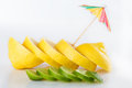 Row of juicy yellow lemon sliced wheels with straw Royalty Free Stock Photo