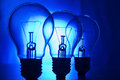 Row of light bulbs on a bright blue background Royalty Free Stock Photo