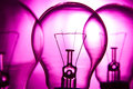 Row of light bulbs on a bright pink background with detail Stock Photography