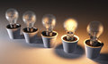 Row of light bulbs in pots view a unlit white except one that is lit with a warm glow on a dark background Royalty Free Stock Images
