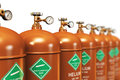 Row of liquefied helium industrial gas containers Royalty Free Stock Photo