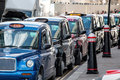 Row Of London Black Taxi Cabs Waiting For Fares. Royalty Free Stock Photo