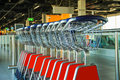 Row of luggage carts in hall of the airport Royalty Free Stock Photo