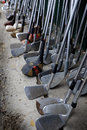 Row of Many Old Used Golf Clubs for Sport Royalty Free Stock Photo