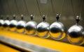 Row of metallic balls for inertia experiments