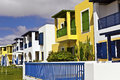 Row of modern houses at the seaside resort two storey flat roof holiday homes by Stock Photo