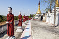 Row monk statues small temple southern myanmar Stock Image