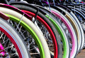 Row multicolored bicycle wheels closeup Royalty Free Stock Photo