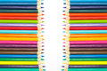 Row of multiple colors wooden pencils, on white background Royalty Free Stock Photo
