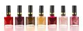 Row of nail polish varied red tone bottles over a white background Stock Photo