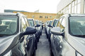 A row of new cars parked at a car dealer shop Royalty Free Stock Photo