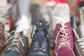 A row of old shoes on a flea market Royalty Free Stock Photo