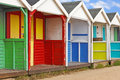 Row of old wooden beach huts a weathered colourful Stock Image