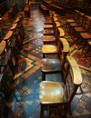 Row of old wooden praying chairs Stock Image
