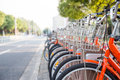Row of orange rental bikes at the roadside in shanghai china Stock Image