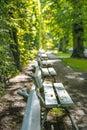 Row of park benches in a city garden Royalty Free Stock Photos
