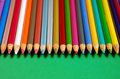 Row of pencil crayons Stock Photography
