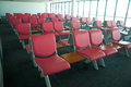 Row of pink chair at airport Stock Images