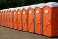 Row of Portable Toilets Royalty Free Stock Photos