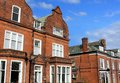 Row of red brick houses in street england Stock Photos