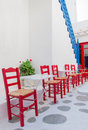 Row of red chairs in a street cafe on the island mediterranean Stock Images