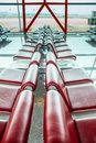 Row of red empty seats at airport terminal. Royalty Free Stock Photo