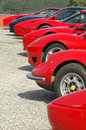 A row of red ferraris in at see donnington park in england Royalty Free Stock Images