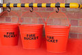 ROW OF RED FIRE BUCKETS Royalty Free Stock Photo