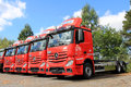 Row of red mercedes benz actros trucks lieto finland august in lieto finland on august starts second half with Royalty Free Stock Images