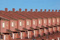 Row of red residential houses in a urbanization in spain Royalty Free Stock Photography