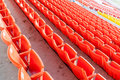 Row of red seats at the football stadium. Royalty Free Stock Photo