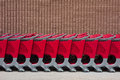 Row of shopping carts a against a wall Royalty Free Stock Images