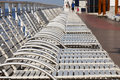 Row of Silver Chaise Lounges on Deck Royalty Free Stock Photography