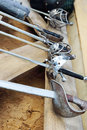 Row of six hilts of rapiers on wooden boards and sand Royalty Free Stock Photo