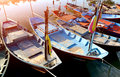 Row of small wooden fishing boats. Royalty Free Stock Photo