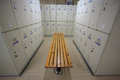 Row of steel lockers along the chair, Locker room for worker in job site, Keep personal belonging in sport complex.