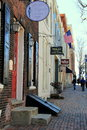 Row of stores on cobblestone walkways old town alexandria virginia picturesque scene with storefronts and their colorful signs Stock Images