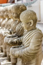 Row of stucco monks in temple little Royalty Free Stock Photography