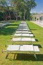 Row of sunbeds beside a lawn Stock Photos
