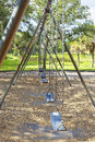 Row of swing seats a empty public a park Royalty Free Stock Photography