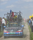 Row of technical vehicles paris roubaix carrefour de l arbre france april following the cyclists on the famous dusty cobblestone Royalty Free Stock Photo