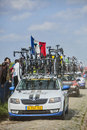 Row of technical vehicles paris roubaix carrefour de l arbre france april following the cyclists on the famous dusty cobblestone Stock Photos
