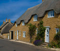 Row of thatched cottages Stock Photos