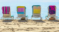 A row of three beach chairs overlooking the sea view Stock Photography