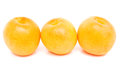 Row from three peaches isolated on white background Stock Photo